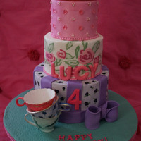 Tea Party Cake imprinted buttercream cake on bottom 2 tiers with gumpaste painted tea cups