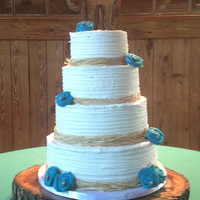 Rustic Teal Wedding Cake bride added teal burlap flowers