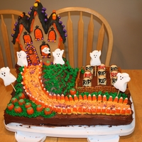 Haunted Mansion Halloween Cake  I make this cake for a halloween kid party. The haunted house was a premade gingerbread house that I decorated. That was a challenge to...