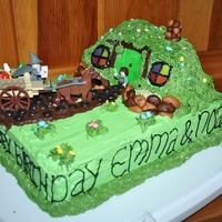 Lord Of The Rings / Hobbit Cake  Made this cake for my kids joint birthday party. I used a lego set for the people and i molded rice krispies for the actual hobbit hole. I...