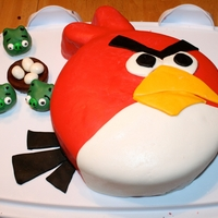 Angry Birds Cake   Cake I made for my 6 year olds party. The pigs are cake balls.