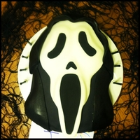 Ghostface From The Scream Movies I made this for my very good friend Joey's 14th birthday he loves the scream movies. It was a red velvet cake with cream cheese icing...