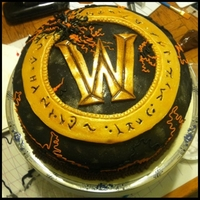 World Of Warcraft The Burning Crusades Logo Cake I made this last year for my Brothers birthday. It's a vanilla cinnamon sponge with chocolate ganache icing covered in fondant. ~...