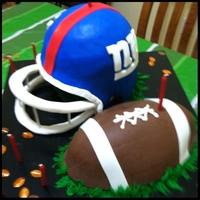 Giants Helmet & Football My new boyfriend's a huge NY Giants fan. so i challenged myself to see if i could do it... Made a helmet and football out of vanilla...