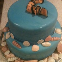 Fish Cake With Molded Sea Shells   shells are fondant. I used a candy mold. Fish are fondant