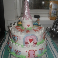 Disney Princess Castle Cake This is my 3rd castle cake, think practise makes perfect, getting better i think!This was a three tier cake, but the tower is made from...