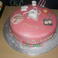 Baking Thtemed Cake This was a cake I made for a 94 year old lady who is a great home maker. The cake is pink regalice and all the toppers are handmade. It was...