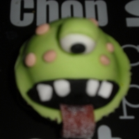 One Eyed Monster Cupcake part of a batch for a halloween competition, this one eyed monster is choclate flavour, the rest is regalice and tongue is sour serbet...