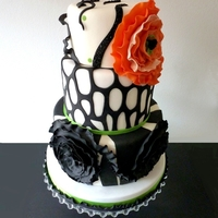 Black And White With Orange Ruffle Flower