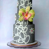 Grey Birthday With Orchid Gumpaste ovals, white flowers and orchid.