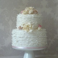 Maggie Austin Style Wedding Cake And Matching Cupcakes White ruffled fondant wedding cake with gumpaste roses.