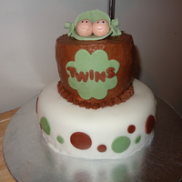 Twins Baby Shower Peas in the pod topper made out of fondant/gum paste. Top cake is lemon cake with lemon cream cheese buttercream. Bottom cake is WASC with...