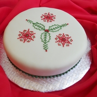 Christmas Cake 5 Fruit cake covered with marzipan and fondant, decorated with royal icing piping.