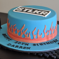 Bikie Flame Cake  This cake was made for a friend. The flames were made using fondant marbled with orange and red and pain stakingly cut by hand. The top is...