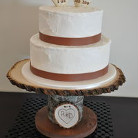 Rustic Wedding Cake This cake was covered in buttercream with a rough rustic texture. The toppers and stand were both purchased through Etsy. I loved the look...