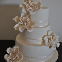 Gardenia Flower Wedding Cake  Ivory cake with Ivory Gardenia flowers. This was a perfect cake for a beautiful winter's day in Melbourne! The bride provided me with...