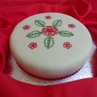 Christmas Cake 7   Fruit cake covered with marzipan & fondant with royal icing piping.