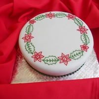 Christmas Cake 2 Fruit cake covered with marzipan & fondant with royal icing piping.