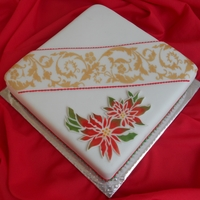 Poinsettia & Scroll Pattern Fruit cake covered with marzipan and fondant with stencil work.