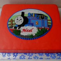Thomas The Train Birthday Cake Chocolate cake filled with dark chocolate ganache, covered in fondant. The thomas the train plaque is made from a mixture of fondant and GP...