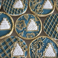 Wedding Cookies Wedding cookies made to match the color scheme of turquoise and gold. The wedding cake pops out as a cookie within a cookie! I originally...