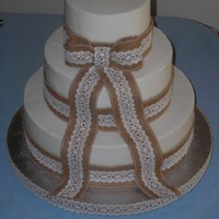 Burlap & Lace Wedding Cake Burlap & Lace ribbon backed with food safe paper to prevent any burlap fibers from getting in the frosting- which was a bit tricky...
