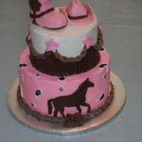 Cowgirl Cake Cowgirl cake with pink paisley bandana, horse silhouette, braided rope border, fringe, stars, cowboy hat and cowboy boots. Thanks for all...