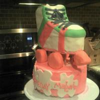 Roller Skate Roller skate made out of layered cake covered in MMF. Base is cake covered in buttercream.