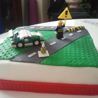 Lego Cake Lego cake for son's 7th birthday. Cake is covered in fondant. Car and man are lego pieces