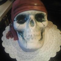 Skull Cake Pumpkin cake in shape of skull covered with fondant. This was my first attempt at using the Wilton Skull pan. It was great, and the cake...