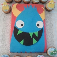 Monster Cake Monster cake and cupcakes made to look like a baby shower invitation.