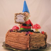 Garden Gnome On Cake With Toadstools All Edible   Garden gnome on cake with toadstools. All edible.