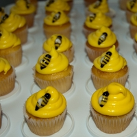 Bee Cupcakes Mini fondant bees on bee hive cupcakes