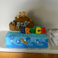 Noah's Ark My son's baby shower cake! Noah's ark was the theme. The inside of the cake was the colors of the rainbow! All the females have a...