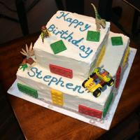 Lego Cake *Chocolate cake with white buttercream frosting with chocolate molded legos and real lego toy added.