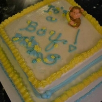 Baby Shower Cake Baby shower cake. Blue Velvet cake with cream cheese frosting and fondant accents. Borders and writing in buttercream.