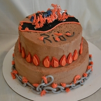 Ghost Rider Cake My son's birthday cake. It's a chocolate cake with chocolate butter cream. Chains and flames are gum paste. Tell me what you...