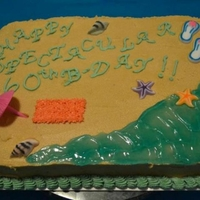 Beach Themed Birthday Cake Chocolate cake with peanut butter frosting with a beach theme