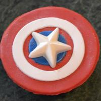 Captain America Cupcakes *Strawberry cupcakes with strawberry frosting and shields made from gumpaste with a chocolate molded star on top.