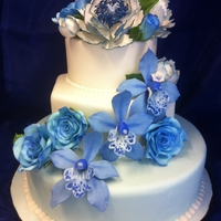 Blue Wedding Cake With Gumpaste Flowers This was my first attempt at gumpaste flowers on a cake. I tried to keep the cake simple so that the blue flowers would really pop. Any...