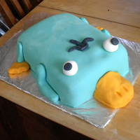 Perry The Platypus Cake My son loves Phineas and Ferb. I made him a Perry the Platypus cake for him. It was 2 13x9 cakes stacked with bill, eyes, and tail attached...
