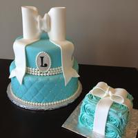 Tiffany Style First Birthday Cake With Matching Smash Cake Large Fondant Bow Quilted Base And Monogram Tiffany style first birthday cake with matching smash cake. Large fondant bow, quilted base and monogram.