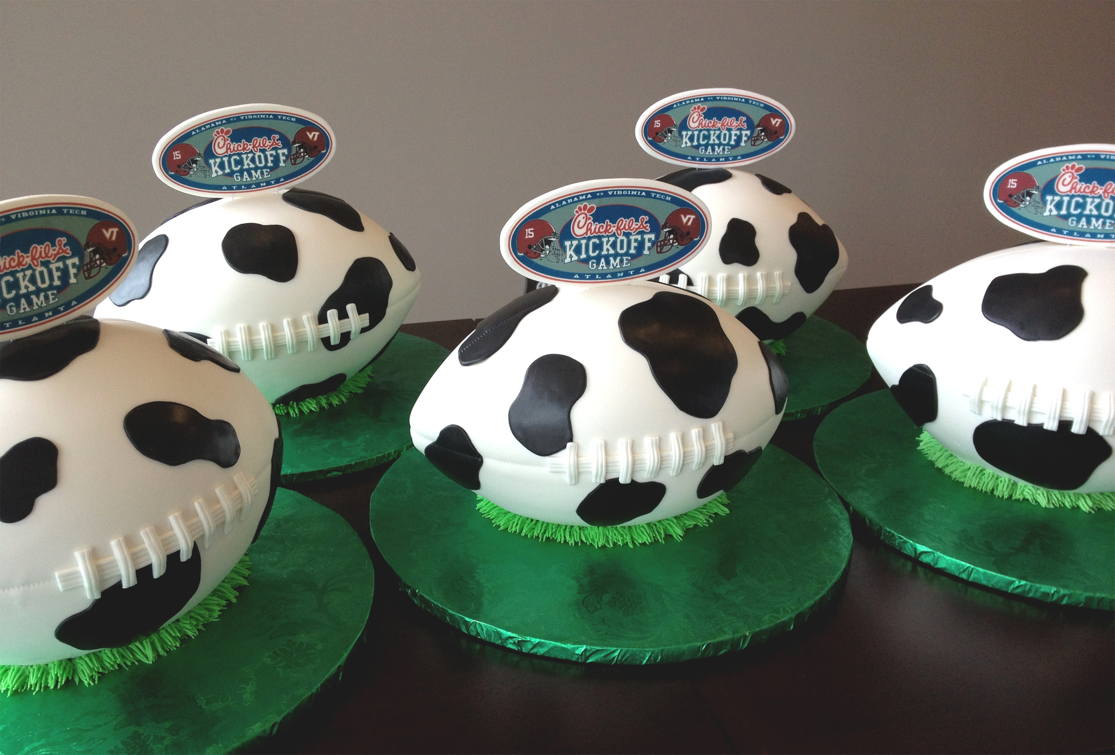 Chick Fil A Cow Spotted Football Cakes For Kickoff Game Chick-fil-A cow spotted football cakes for Kickoff game.
