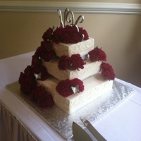 White Square Wedding Cake With Scrolls And Carnations White Square wedding cake with scrolls and carnations