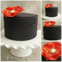 Black Fondant Beads And A Burnt Orange And Gold Gum Paste Flower Black fondant beads and a burnt orange and gold gum paste flower.