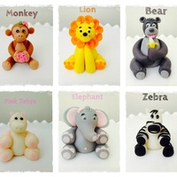 Gum Paste Animal Cake Toppers For A Birthday Cake Lion Monkey Zebra Elephant And Bear Gum paste animal cake toppers for a birthday cake. Lion, monkey, zebra, elephant and bear.