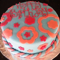 Pink Blooms Fruit cake covered in fondant with fondant accents and writing in butter cream