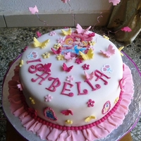 Pink Princess Chocolate cake covered with fondant. The Disney princess stickers are edible.