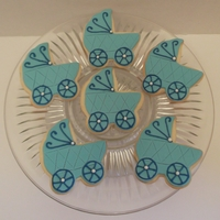 Baby Buggies Baby carriage rolled almond butter cookies with fondant. Accented with royal icing and tiny pearl dragees.