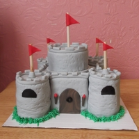 Cobblestone Castle My first attempt at a castle. The main cake is a 4 layer, 6 inch square marble cake with a 2 layer, 4 inch round cake on top. The turrets...